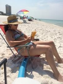 Katie Reading on the Beach