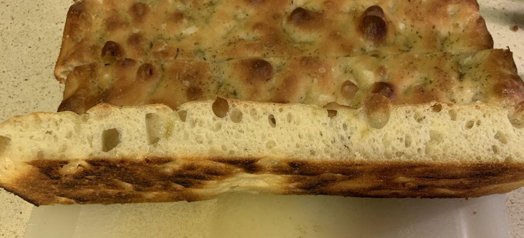 sliced focaccia showing bubbly crumb