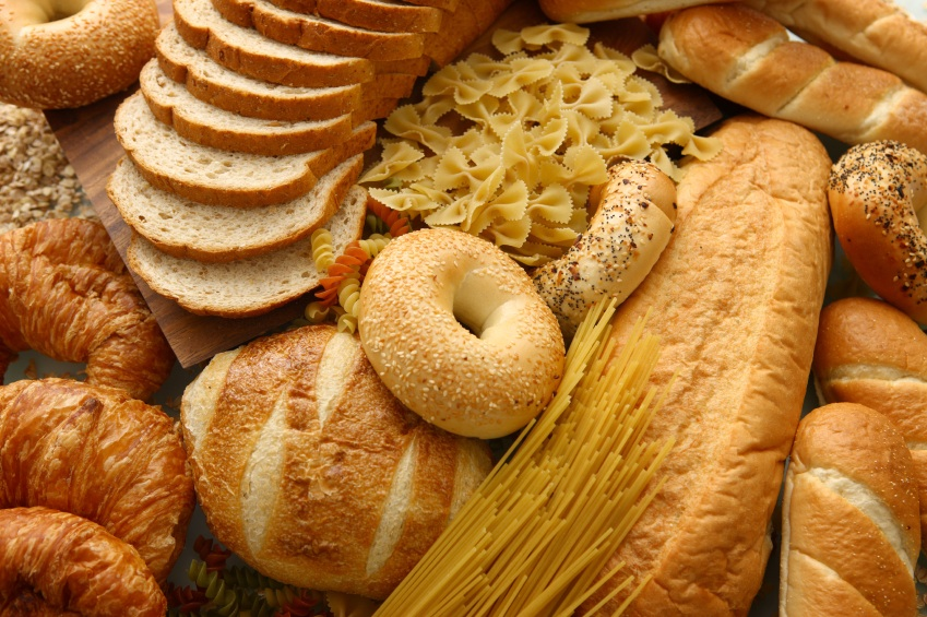 various breads, patries, and pastas piled together