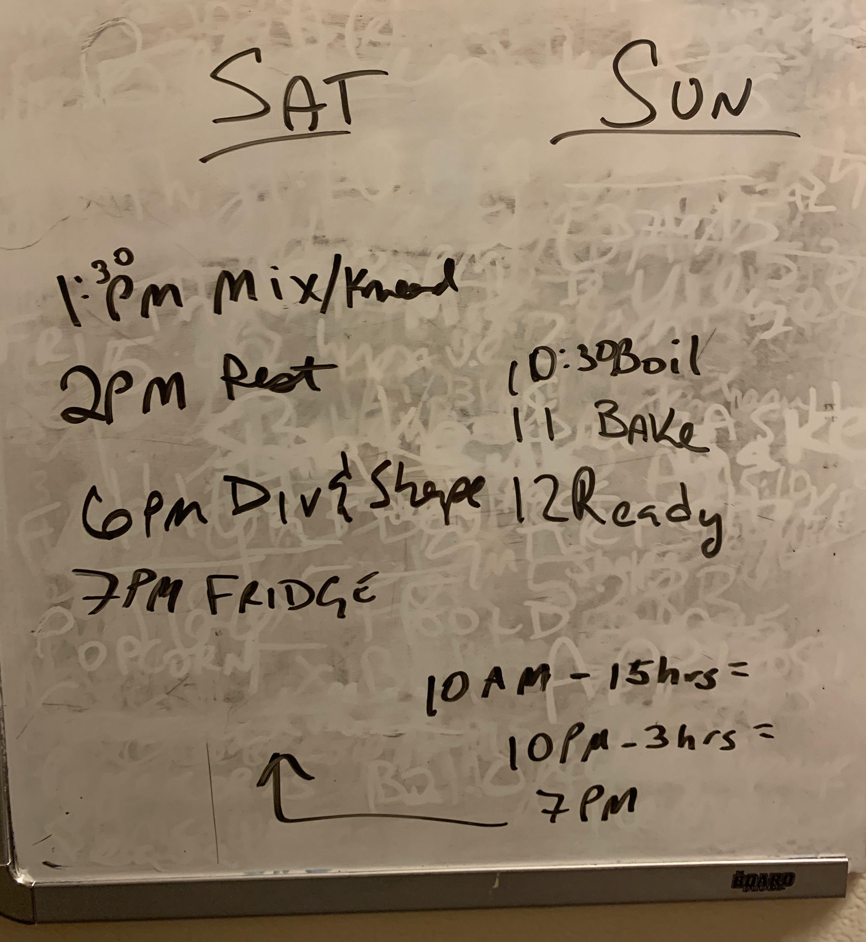 dry erase board with timing and steps for baking written out